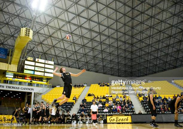 Long Beach State's Eric Ensing serves against the University of British Columbia during the 49ers' exhibition victory Thursday night in Long Beach....