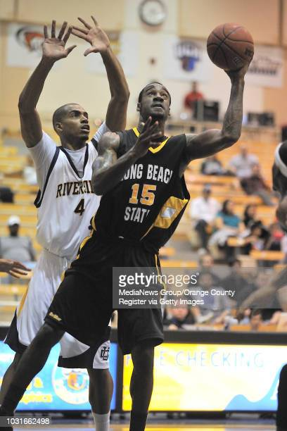RIVERSIDE CA Long Beach State's TJ Robinson goes up for a shot as UC Riverside's Bryson Hampton finds himself on the wrong side to defend their...
