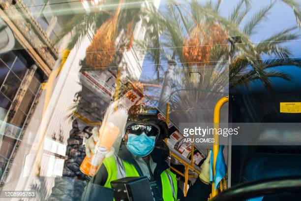 TOPSHOT Long Beach Transit Worker Mateo Alvorado disinfects a bus in Long Beach California on April 2 2020 The United States recorded 1169 COVID19...