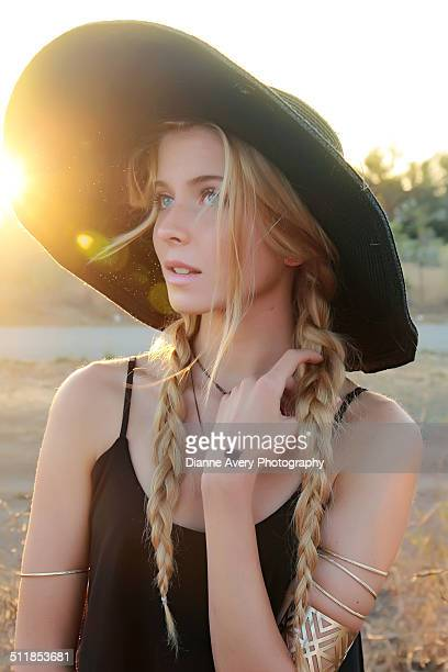 long blond braids teen girl in field - wide brim stock pictures, royalty-free photos & images