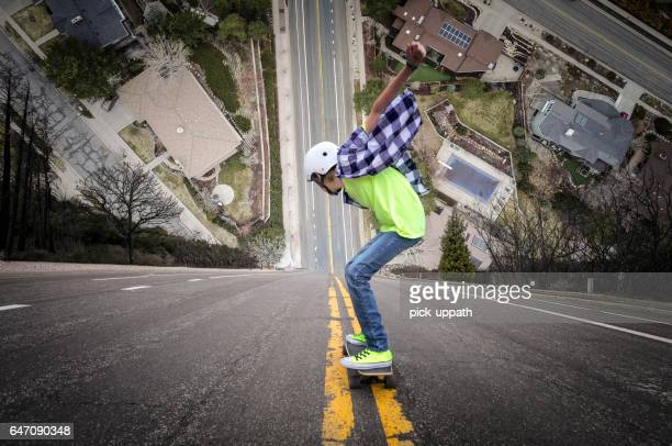 long boarding down super steep hill - steep stock photos and pictures