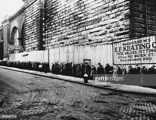 A long bread line near the Brooklyn bridge during the Great Depression New York New York ca 19301935