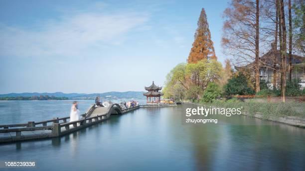 long bridge park,west lake,hangzhou - west lake hangzhou stock pictures, royalty-free photos & images