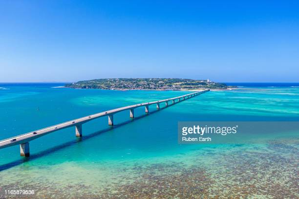 a long bridge to kouri island in okinawa - okinawa prefecture stock pictures, royalty-free photos & images