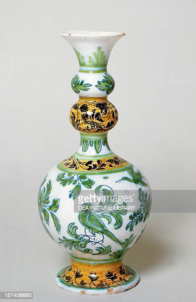 Long bulbed neck bottle decorated in chiaroscuro green ceramic Nevers manufacture Burgundy France 17th century Sevres Musée National De Céramique