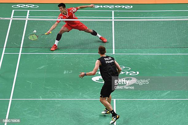 Long Chen of China competes against Adrian Gavnholt of Poland during the Men's Singles Play Stage Group p match on Day 8 of the 2016 Rio Olympics at...