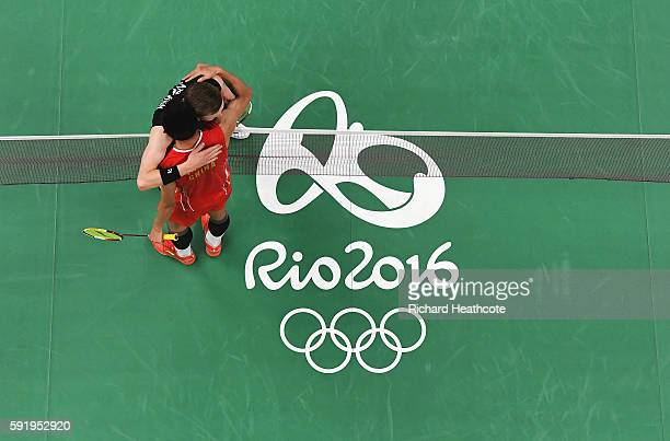 Long Chen of China embraces Viktor Axelsen of Denmark after winning the Men's Singles Badminton Semifinal on Day 14 of the Rio 2016 Olympic Games at...