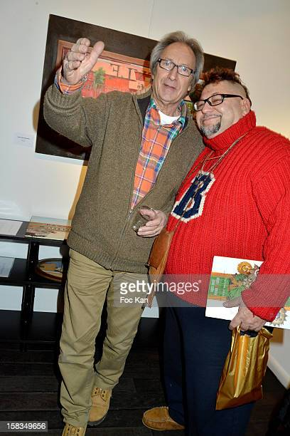 Long Chris and a friend attend the 'Amerique Instantanes' Laurent Hubert Painting Exhibition Preview at Galerie Myriane on December 13 2012 in Paris...