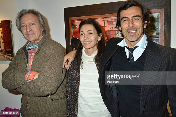 Long Chris his daughter Adeline Blondieau and Laurent Hubert attend the 'Amerique Instantanes' Laurent Hubert Painting Exhibition Preview at Galerie...