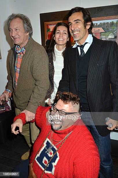 Long Chris, his daughter Adeline Blondieau, Laurent Hubert and a guest attend the 'Amerique: Instantanes' - Laurent Hubert Painting Exhibition...