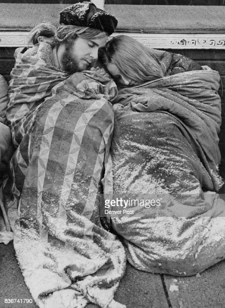 Long Cold Wait Robin Theil dozes on the shoulder of William Berglin as the two Colorado Springs residents braved the snow and below- freezing...