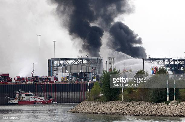 A long column of smoke rises from the Chemical plant of the BASF site in Ludwigshafen western Germany on October 17 2016 Several people were missing...