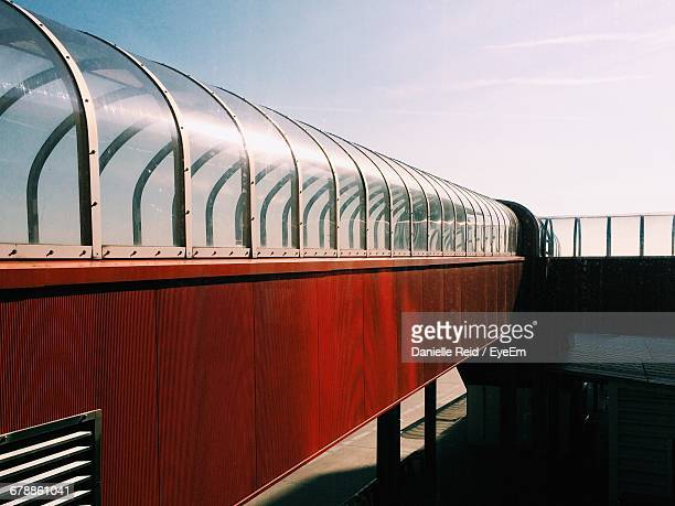 long covered footbridge against the sky - danielle reid stock pictures, royalty-free photos & images