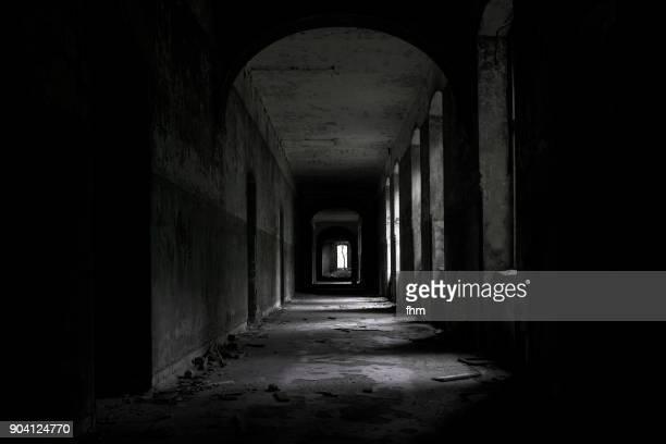 A long dark corridor in an abandoned hospital