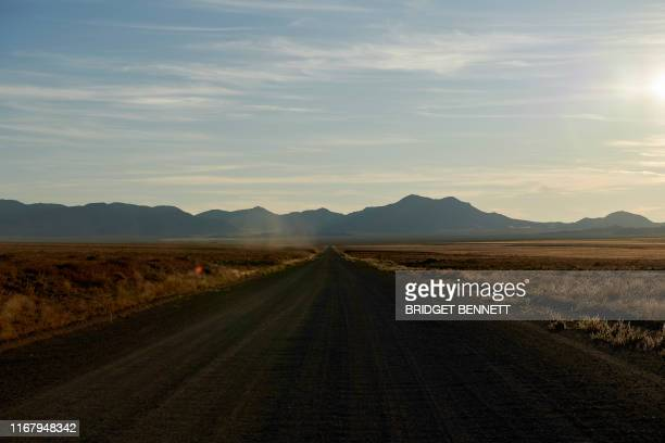 Long, desolate dirt road leads to a gate of the Nevada Test and Training Range, commonly referred to as Area 51, near Rachel, Nevada, on September...