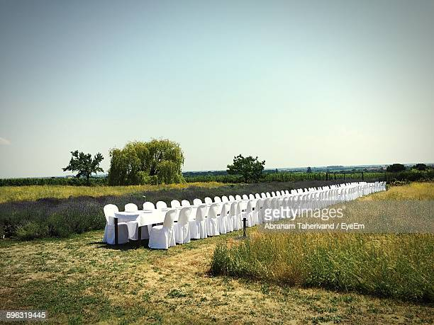 long dining table under clear sky - long stock pictures, royalty-free photos & images
