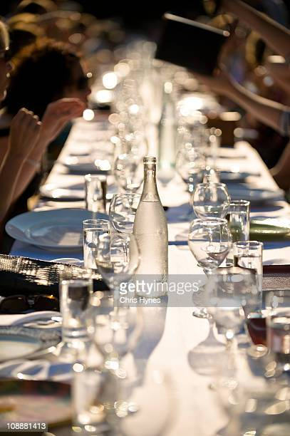 long dinner table with guests - madison grace stock pictures, royalty-free photos & images