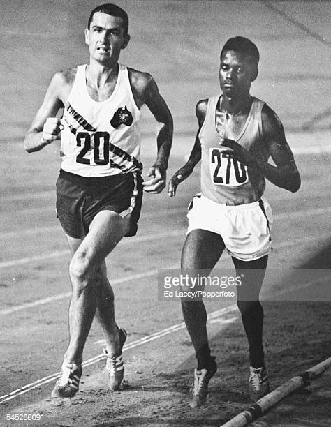 Long distance runners Ron Clarke of Australia and Naftali Temu of Kenya compete in the 6 mile race which Temu eventually won at the Commonwealth...