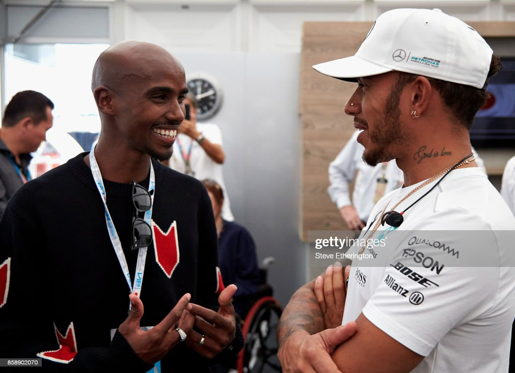 Long distance running legend Sir Mo Farah talks with Lewis Hamilton of Great Britain and Mercedes GP in Mercedes GP hospitality before the Formula One Grand Prix of Japan at Suzuka Circuit on October 8, 2017 in Suzuka.
