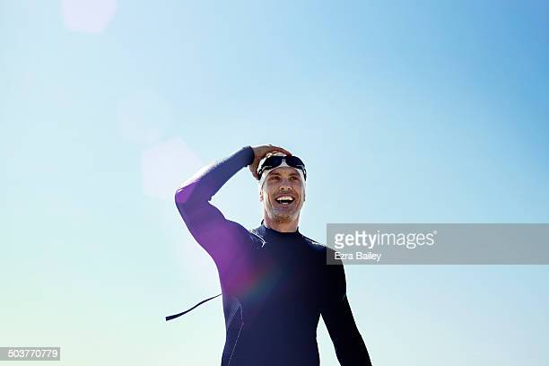 long distance swimmer smiling and celebrating. - triathlon stock pictures, royalty-free photos & images