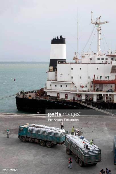 Long distance trucks loaded with 800 bags of wheat each bound for Ethiopia are parked at the WFP, World Food Program storage facility in the Djibouti...