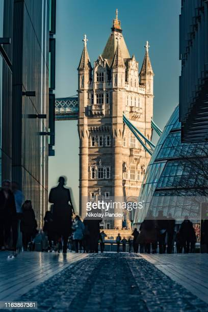long distance view towards tower bridge in city of london, england - creative stock image - london bridge england stock pictures, royalty-free photos & images