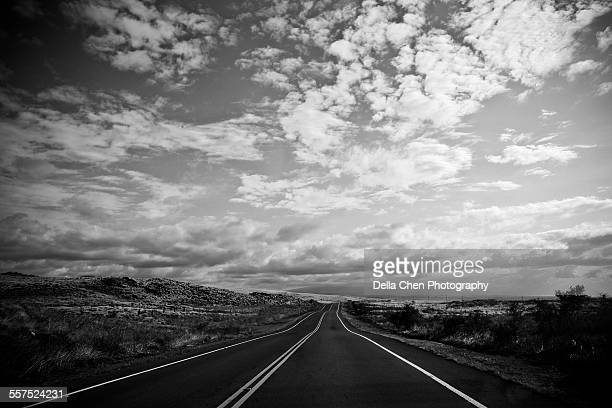 long empty road with dramatic clouds and sky. - dividing line road marking stock photos and pictures
