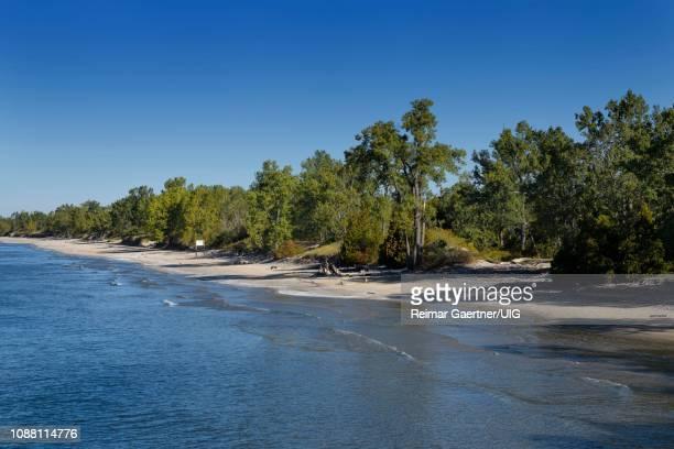 long empty sandbanks beach in sandbanks provincial park on lake ontario, prince edward county canada - lake ontario stock pictures, royalty-free photos & images