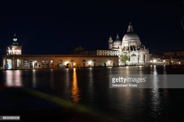 long exposre view on punta della dogana and church, night, venice, italy - punta della dogana stock photos and pictures