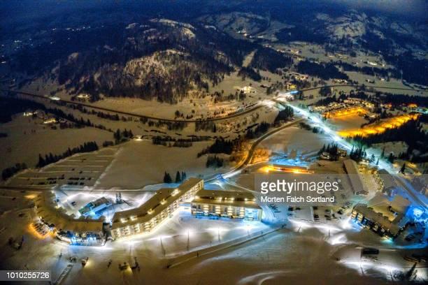 long exposure aerial shot of hemsedal ski resort, norway on a winter night - ski resort stock pictures, royalty-free photos & images