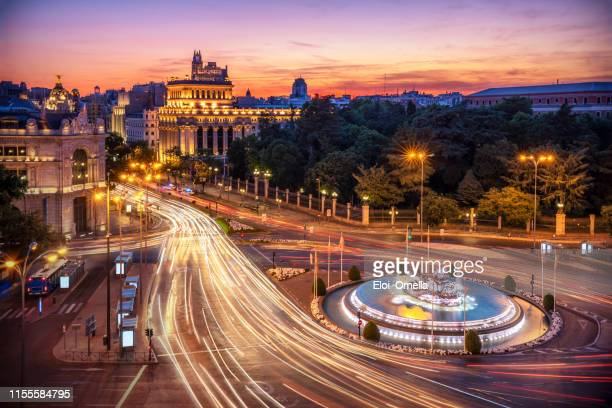 long exposure aerial view and skyline of madrid with cibeles fountain at dusk. spain. europe - madrid stock pictures, royalty-free photos & images