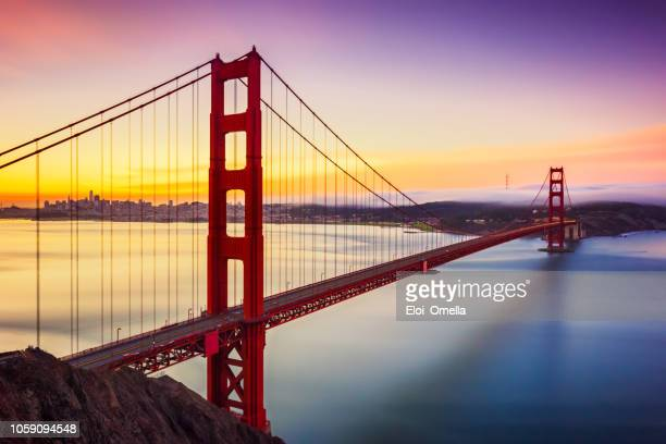 long exposure before sunrise in golden gate bridge, san francisco, usa - san francisco california stock photos and pictures