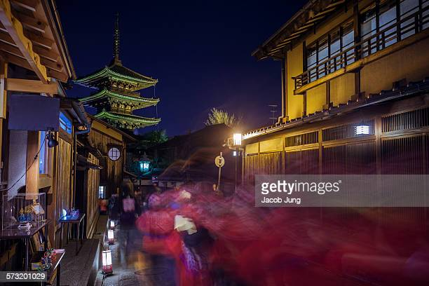 Long exposure blurred motion shot of the passing Fire Watch during the Hanatoro lantern illumination event in Kyoto's Higashiyama district with...