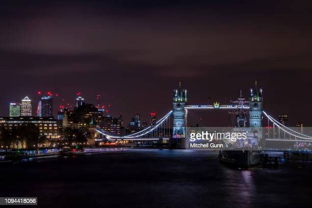 A long exposure general view of Tower Bridge HMS Belfast and the river Thames on January 9 2019 in London United Kingdom