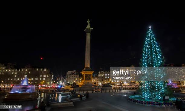 Long exposure general view of Trafalgar Square, Nelsons Column, and the Christmas tree donated yearly by the people of Norway, on December 12, 2018...