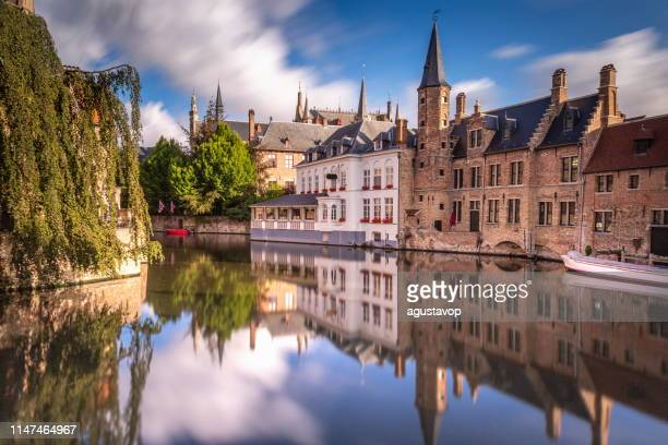 long exposure idyllic blurred rozenhoedkaai at sunrise – bruges - belgium - tourism stock pictures, royalty-free photos & images