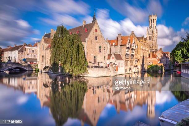 long exposure idyllic blurred rozenhoedkaai at sunrise – bruges medieval old town - belgium - bruges stock pictures, royalty-free photos & images