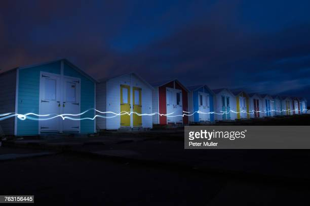Long exposure image of lights by beach huts at night, Bude, Cornwall, United Kingdom, Europe