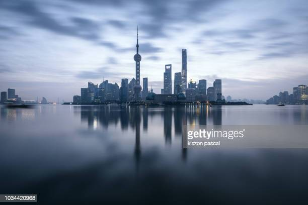 long exposure in lujiazui district in shanghai during morning , china . - reflection pool stock pictures, royalty-free photos & images