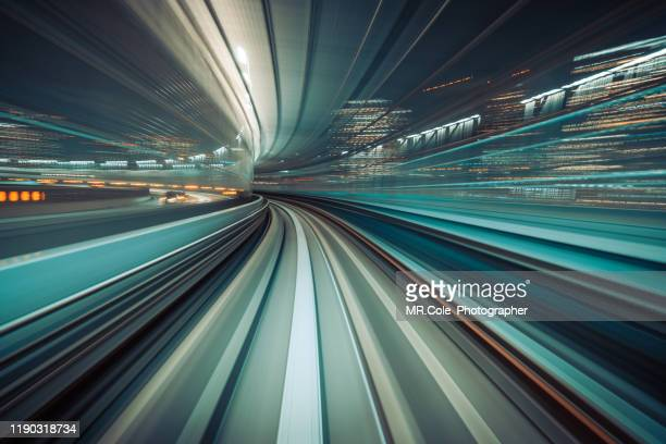long exposure light trails of  train moving in tunnel,automated transit system controlled entirely by computers with no drivers on board,transportation technology,futuristic abstract background - 人工知能 ストックフォトと画像