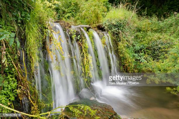 long exposure of a waterfall at lee bay in exmoor national park - lynton stock pictures, royalty-free photos & images
