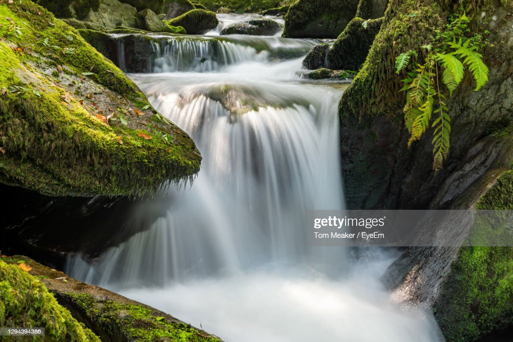 Long Exposure Of A Waterfall Flowing Through The Woods At Watersmeet In Exmoor : Stock Photo