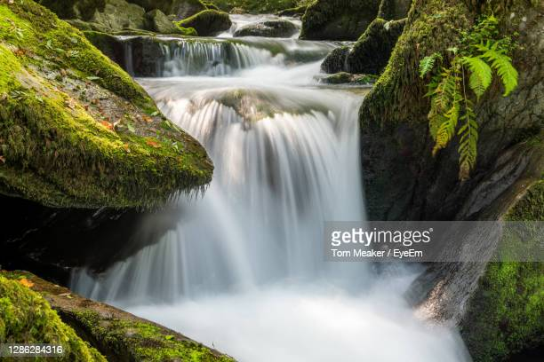 long exposure of a waterfall on the hoar oak water river at watersmeet in exmoor national park - flowing stock pictures, royalty-free photos & images