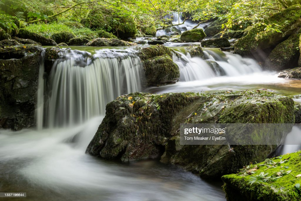 Long Exposure Of A Waterfall On The Hoar Oak Water River At Watersmeet In Exmoor National Park : Stock Photo