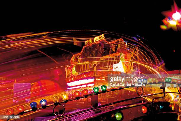 Long exposure of colourful lights on a fairground ride taken on September 22 2009