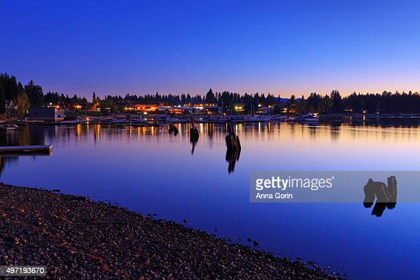 Long exposure of downtown McCall Idaho reflected in Payette Lake at dusk, autumn