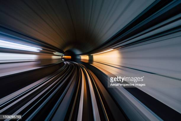 pov long exposure of dubai subway tunnel - united arab emirates stock pictures, royalty-free photos & images