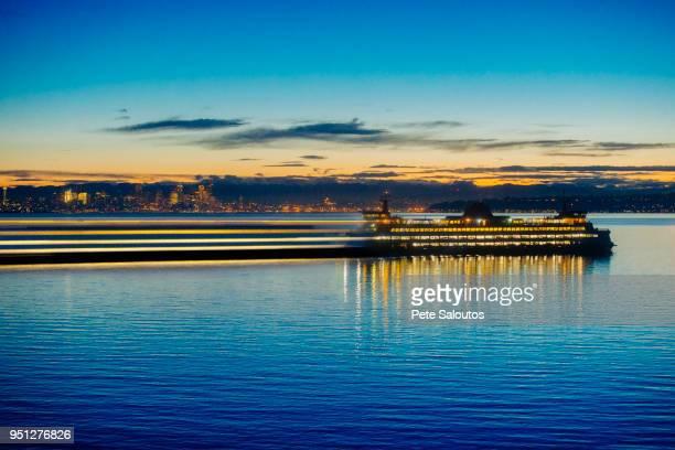 long exposure of ferry on puget sound at sunset, bainbridge, washington, united states - kitsap county washington state stock pictures, royalty-free photos & images