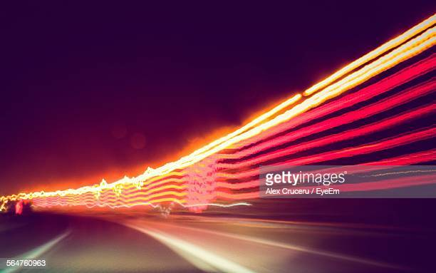 Long Exposure Of Headlights With Tail Lights On Road