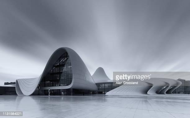 long exposure of heydar aliyev centre - heydar aliyev stock pictures, royalty-free photos & images